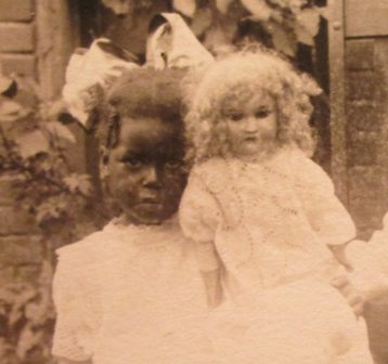 Black girl, white doll