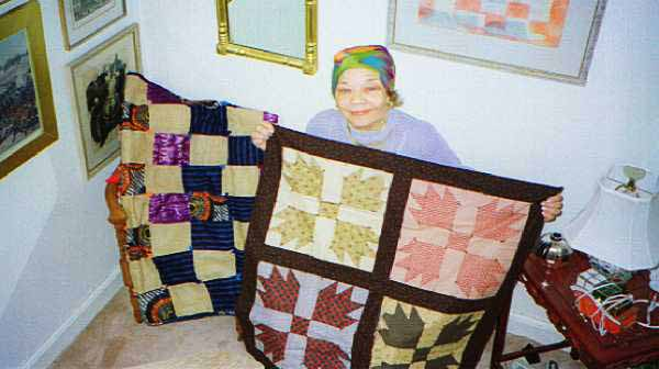 Gloria Bowens with quilts.